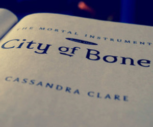 the mortal instruments, city of bones, and book image