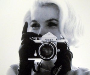 Marilyn Monroe, camera, and black and white image