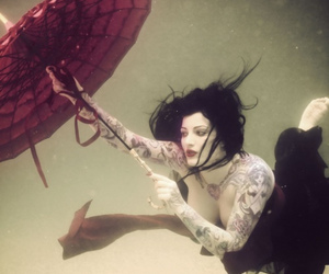 tattoo, umbrella, and underwater image