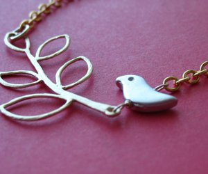 bird, twig, and necklace image