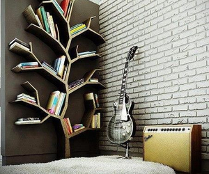 book, tree, and guitar image