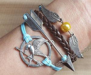 sword, bracelet, and the hunger games image