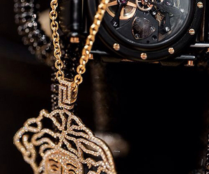 black, gold, and chain image