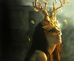 mask, gold, and tree image