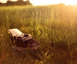 typewriter, grass, and sun image