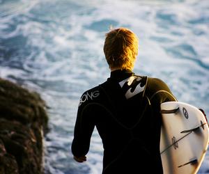 boy, surf, and sea image