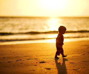 beach, child, and sea image