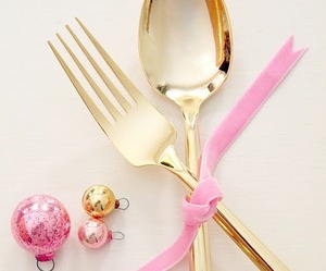 pink ribbon, gold spoon, and gold fork image