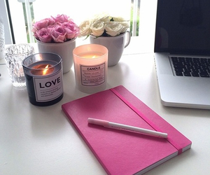 candles, notebook, and pink image
