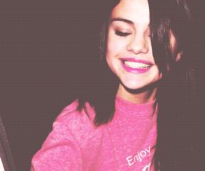 selena gomez, smile, and pink image