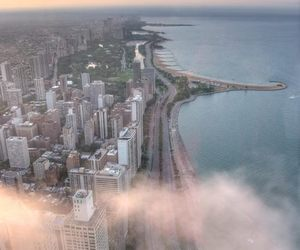 city, clouds, and sea image