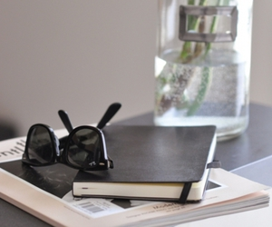 sunglasses, book, and notebook image