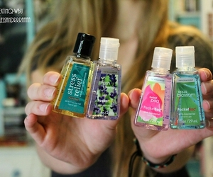 girl and hand sanitizer image