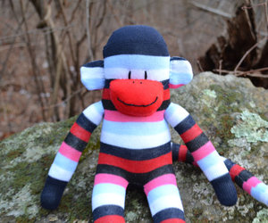 blue sock monkey, sock monkey doll, and green sock monkey image