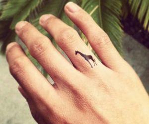 tattoo, giraffe, and finger image