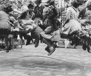black and white, jump, and kids image
