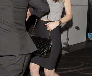kylie jenner, black pencil skirt, and lace up sandals image