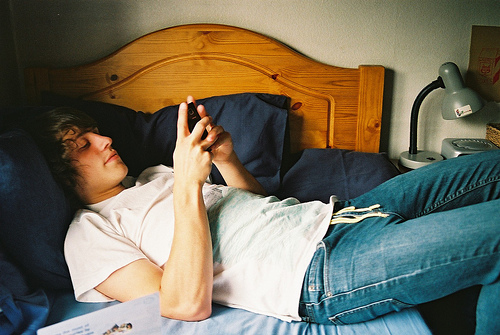 bed, boy, and phone image