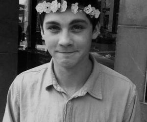 logan lerman, boy, and flowers image