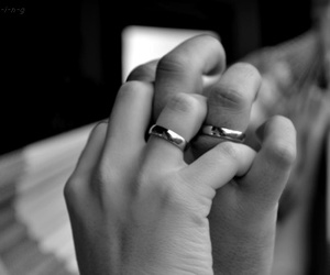 black and white, rings, and hand in hand image