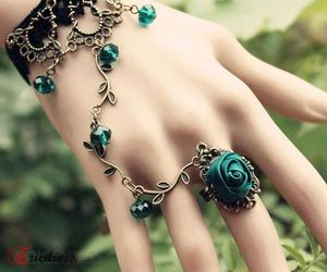 bracelet, ring, and rose image