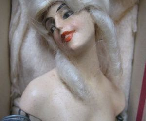 doll, powdered wig, and sculpture image