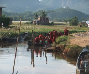 boat, monks, and Buddhist image