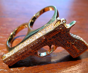 ring, gun, and gold image