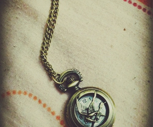the hunger games, mockingjay, and clock image