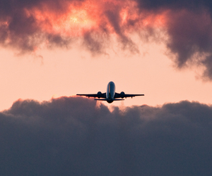 sky, plane, and clouds image