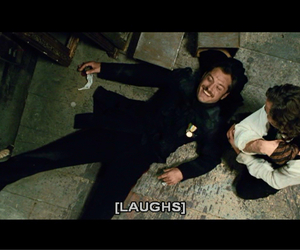 jude law, laughs, and all black image