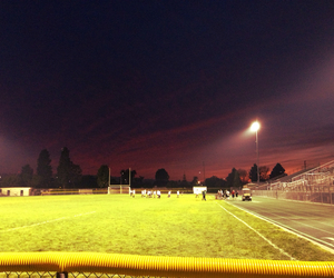 sunset, soccerfield, and redsky image