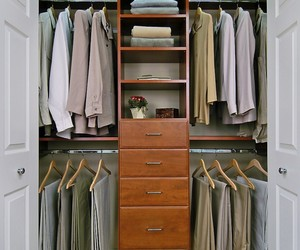 furniture, closet space, and wooden wardrobe image