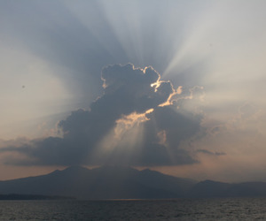 clouds, ocean, and rays image