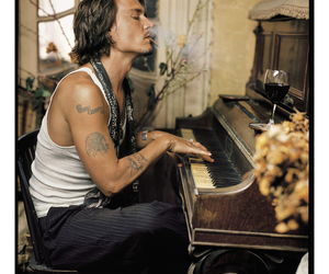 actor, johnny depp, and piano image