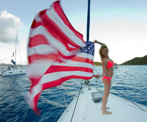 boat, city, and flag image