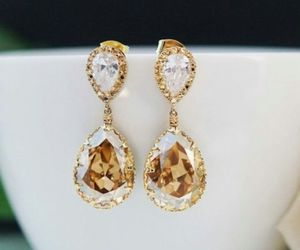 earrings, gold, and diamond image