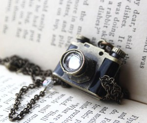 book, camera, and necklace image