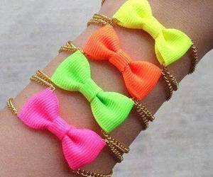 bow, bracelet, and neon image
