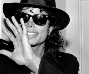 black and white, king of pop, and curls image