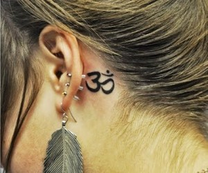 aum tattoo behind the ear image